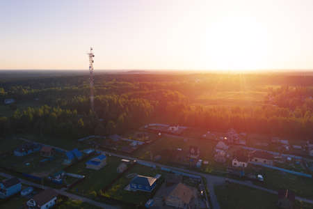 Country village in field near forest. Sunset. Drone view Reklamní fotografie - 153700546