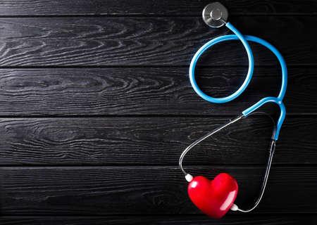 Stethoscope on wooden background. Medicine concept. Nobody Reklamní fotografie - 153664321