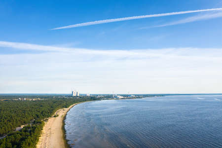 Smoking cooling towers at nuclear power plant near sea. Aerial view from drone Reklamní fotografie - 153664407