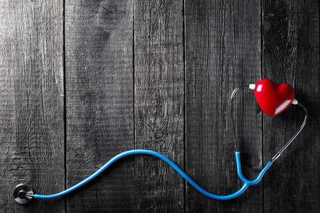 Stethoscope on wooden background. Medicine concept. Nobody Reklamní fotografie - 153664439