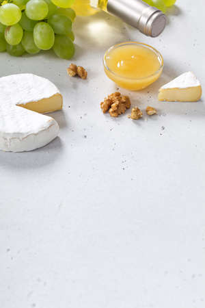 Camembert with cheese fork on white backround. Top view Reklamní fotografie