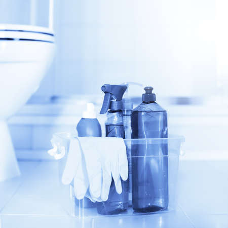 Cleaning detergent products with gloves in conteiner for room service in restroom. Sanitary equipment for disinfect home Reklamní fotografie