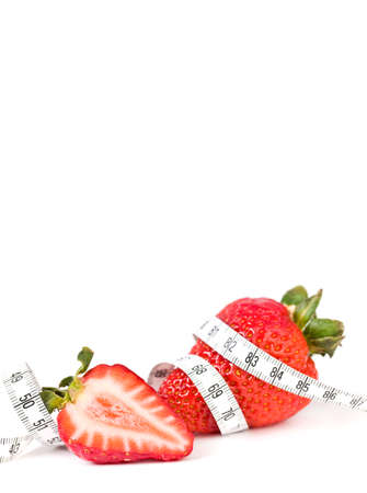Strawberry with measure tape, closeup on white. Long banner