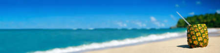 Pineapple cocktail on sand on caribbean beach. Travel summer vacation. Tropical destinations. Punta Cana. Dominican Republic. Long banner with copy space for your text