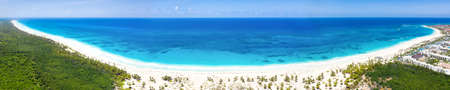 Tropical beach with coconut palm trees and turquoise caribbean sea. Bavaro beach. Punta Cana. Dominican Rebublic. Beautiful travel destination for summer holidays. Panorama view from drone