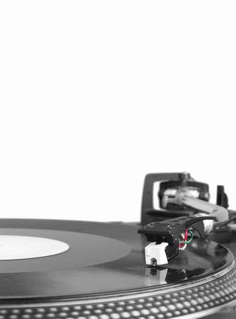 Dj needle on spinning turntable, closeup on white background Reklamní fotografie