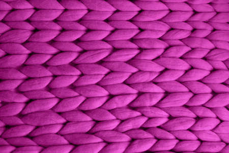 Top view of knit merino blanket of bright pink orchid color, super chunky yarn texture 스톡 콘텐츠