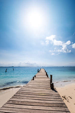 Wooden pier on tropical beach. Travel destinations. Nobody 스톡 콘텐츠