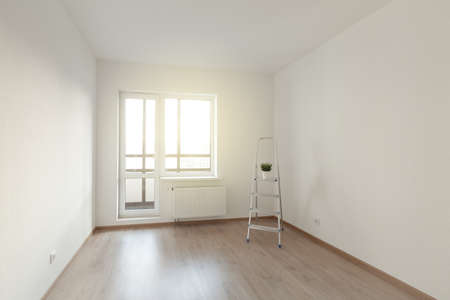 Empty room with white wall interior, ladder and window view. Property Estate concept, no furniture 스톡 콘텐츠