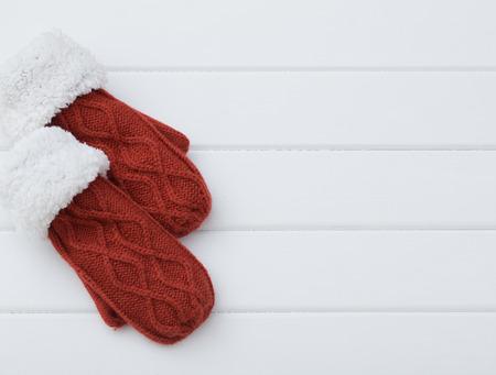 mittens: red mittens on wooden background