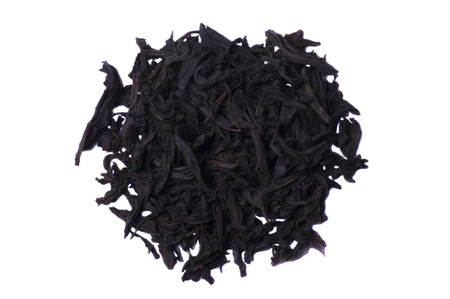 loose leaf: pinch of loose leaf black tea. Isolated on a white background. Stock Photo