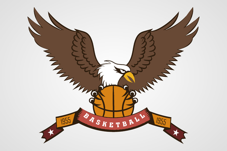 wild eagle with the ball in his paws. sports the emblem of the basketball team. logo, icon. ribbon with the inscription.