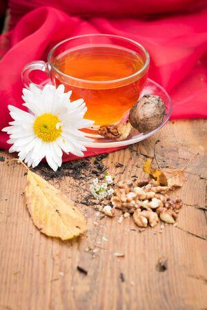 mug of tea with lemon and nuts on a wooden stand. I love autumn. I love tea. Foto de archivo