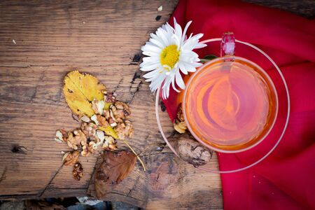 mug of tea with lemon and nuts on a wooden stand. I love autumn. I love tea. Фото со стока