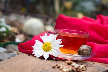 mug of tea with lemon and nuts on a wooden stand. I love autumn. I love tea. Standard-Bild