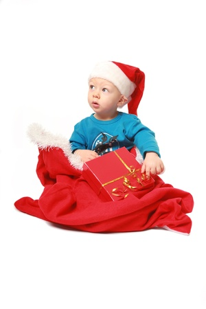 astonished little boy with giftbag isolated on white photo