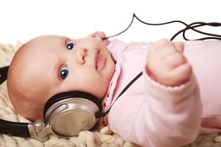 beautiful little girl listening to the music photo