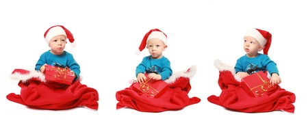 three little gnomes isolated on white Stock Photo - 8363405
