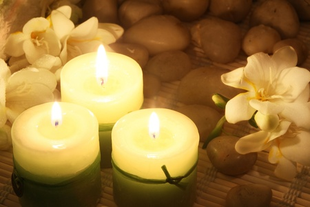 composition of candles and freesias in dark photo