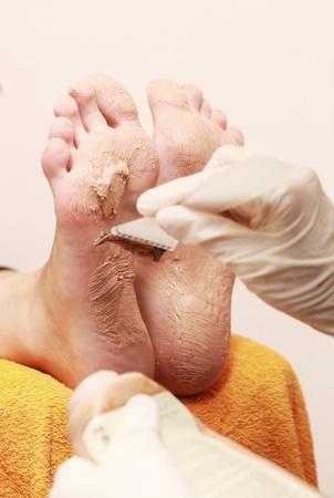 hand rubbing: womans feet on pedicure procedure