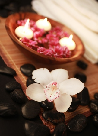 massage herbal: spa composition with flowers towels stones and candles