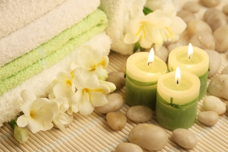 candle wick: soft towels, burning candles and white stones Stock Photo