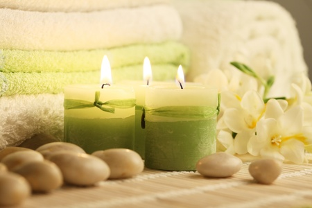 towels candles stones and freesias photo
