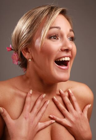 high key: woman looking surprised over grey background Stock Photo