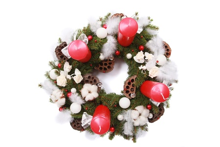 adventskranz: christmas wreath with red candles isolated on white