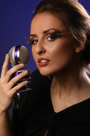 beautiful woman holding microphone photo
