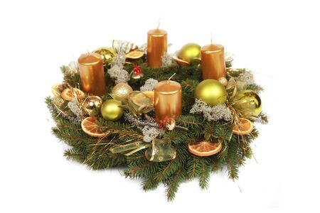 advent wreath with golden candles isolated on white photo