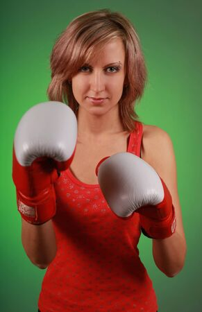 beautiful young woman in boxing gloves photo