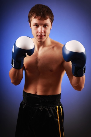 young healthy boxer on blue Stock Photo - 8511826