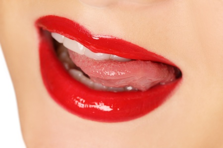 lips and tongue of young beauty