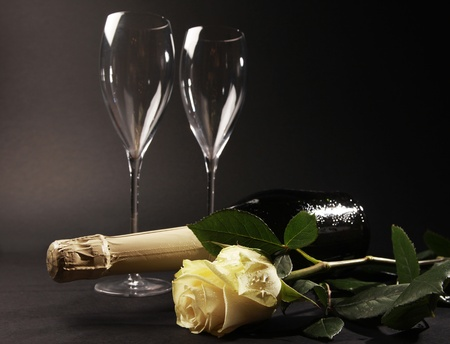 bottle of champagne glasses and rose photo
