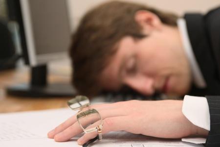 office worker asleep on desk