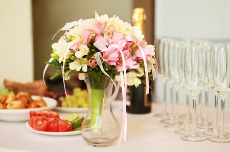 decorated table with bunch of flowers photo