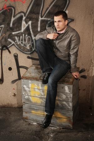 young stylish man posing outdoors photo