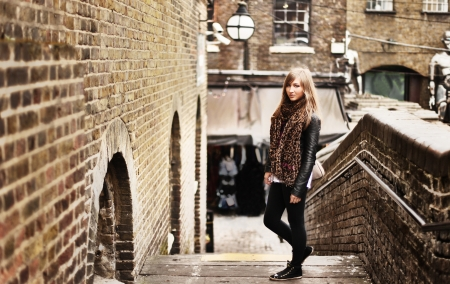 leggings: stylish atractive woman standing on stairs