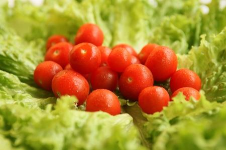 better living: fresh cherry tomatoes on lettuce leaves