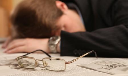 businessman fell asleep at work