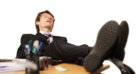 tired businessman asleep at work photo