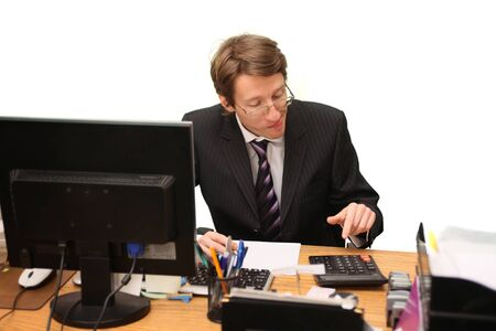 young businessman calculating  photo