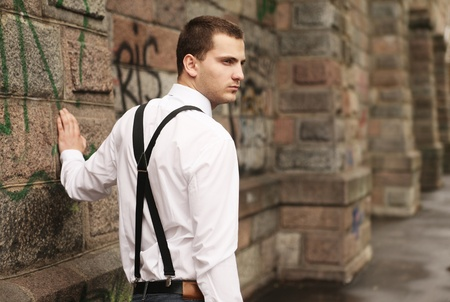 young handsome guy against the stone wall Stock Photo - 11408194