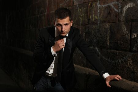 young stylish man standing in dark Stock Photo - 11408237