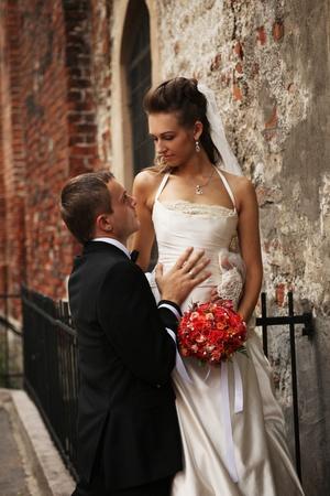 faithful: beautiful couple near old chapel