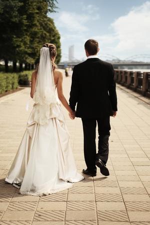 man and wife walking along quay Standard-Bild