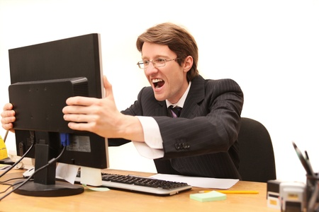 businessman shouting at LCD monitor isolated on white photo