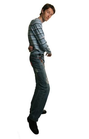 hombre flaco: hombre alto y bailando salsa en blanco Foto de archivo