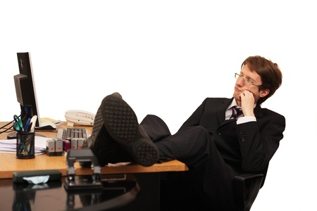 discontent: businessman sitting on chair and thinking